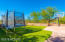 Large Play Area with Basketball Court, Artificial Turf and Lighting.