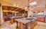 Kitchen has Wolf Double Ovens and Side by Side Sub-Zero Fridge/Freezer.