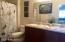 Executive height dual vanity, garden tub and shower en suite master bath.