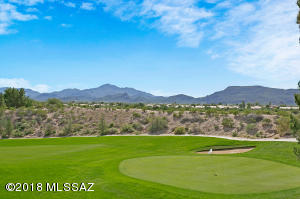 Tucson mountains, golf course, sunset and monsoon views