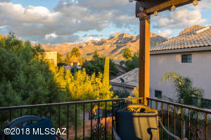 Enjoy the sunrises and sunsets that only Tucson can offer and the beautiful Catalina Mountain on your private, covered deck off the master bedroom.