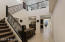 Stairway leads up to a loft/game room, private guest room and bathroom