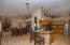 Family room/dining area opens to the kitchen with breakfast bar.