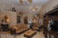Formal Livng/Dining area. Soaring ceilings, niches, ceiling fans and lovely tile floors .