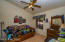 Bedroom, vaulted ceiling , ceiling fan and again no carpet.