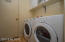 Nice laundry room with cabinets.