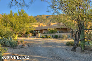 Set near the base of the Catalinas on just under 4 acres