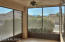 Cozy screened in patio with morning sunrise and mountain views