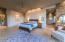 Cove ceiling, stacked stone accents give drama to this room