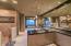 Separate vanities & toilet rooms, expansive granite counters