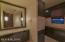 Pool bath off family room area. Lg walk-in tiled shower.