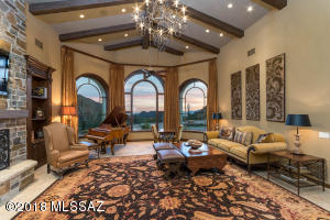 This grand great room boasts the finest of custom craftsmanship and hosts exquisite daytime and sunset views.