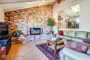 Wall of brick with expansive fireplace is at the far end of the living room - picture window to the Catalina's to the left and the formal dining room to the right