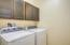 Separate Laundry Room with Cabinetry