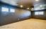 Upstairs Theater Room with Large Screen and Projector