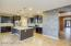 Island Kitchen with Custom Tile Wall and Stainless Appliances