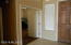Front bedroom or office with double doors.