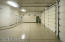 Large immaculate garage with tons of storage and workshop area
