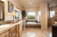Spacious master bath has it all-Dual vanities, jetted tub, upgraded fixtures/lighting, walk-in shower, big windows for natural light and huge walk in closet