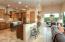 Custom alder wood cabinets, granite counters, ss appliances, walk-in pantry & breakfast bar