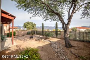 Surround yourself with Tanque Verde Valley and Catalina Mountain views from the master bedroom side of your back yard...