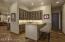 Wet Bar w/Onyx countertops, ice maker & beverage fridge.