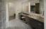 Granite counters, metal sink, bidet and commode.