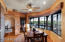 Nice eating area with a panoramic view. Kitchen is to the left side of the photo with an opening.