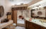 Glass bowl sink, tile, framed mirror.