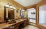 Petrified wood sinks, jetted tub, separate shower and not seen in this photo is a large walk-in closet.