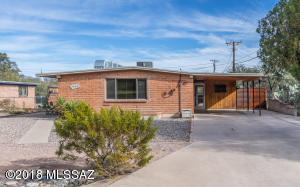 Darling Brunt Adobe home with vintage Knotty Pine preserved in Carport & adjoining Laundry Room.