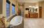 Jacuzzi tub, separate vanities and generous shower