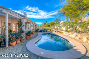 1/4 Acre Yard ~ Sparkling Pool & Beautiful Rose Garden!