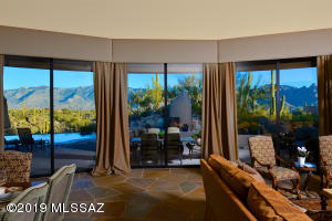 Gracious puddling drapes enhance the 3 separate sets of double windows which showcase amazing east-facing Catalina views.