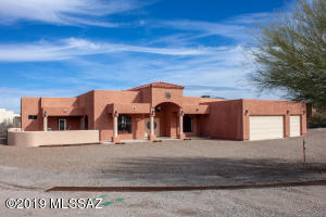 Super location easy access to I-10 on approx 1 acre lot with city lights and mountain views!