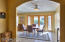 Arched entry to dining area with lovely french doors leading to EAST patio...beautiful sunrise views
