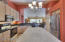 """42"""" Cabinets with rollouts and under cabinet light, plus chandelier over island"""