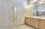 Walk in closet, dual sinks, linen closet and walk-in shower