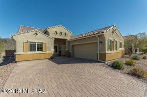 Brick paver driveway, turned 2 car garage and a landscaped yard welcome you to 9808 N Saguaro Breeze Way.