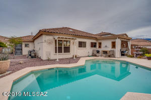 Located in the desirable gated community of The Villages of La Canada complete with sparkling pool, two-way outdoor fireplace, and soothing fountain.