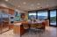 Gourmet kitchen w/stainless appliances & mesquite butcher top island.