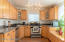 Remodeled Kitchen includes custom cabinets with easy slide drawers and stainless steel appliances.