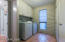 Laundry room with cabinets.
