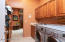 Spacious laundry room w/washer & dryer and additional storage cabinets