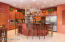 """42 """" raised panel cabinets, under cabinet lighting, pantry & casual dining area"""