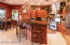 Gourmet kitchen w/ Granite counters, cherry cabinets & breakfast bar and eating area