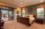 Maser suite w/double door entry & sliding door leading to covered patio
