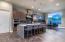 Gourmet island kitchen with SS KitchenAid appliances.