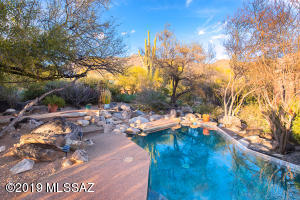 LUSHLY VEGITATED POOLSIDE OFFERS PRIVACY AND SHADE
