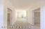 LOOKING DOWN HALLWAY FROM MASTER BEDROOM TO MASTER BATH. ENTRANCES TO THE SEPARATE CLOSETS